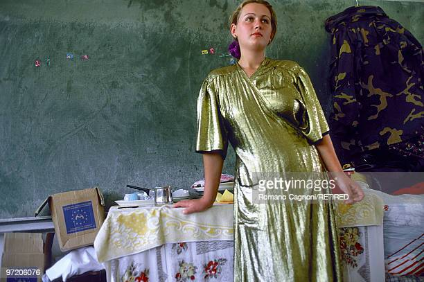 Bosnia and Herzegovina Tuzla refugee camp Senada Halivovic from Srebrenica When fleeing the war she took her golden lam� dress which she had sewn and...