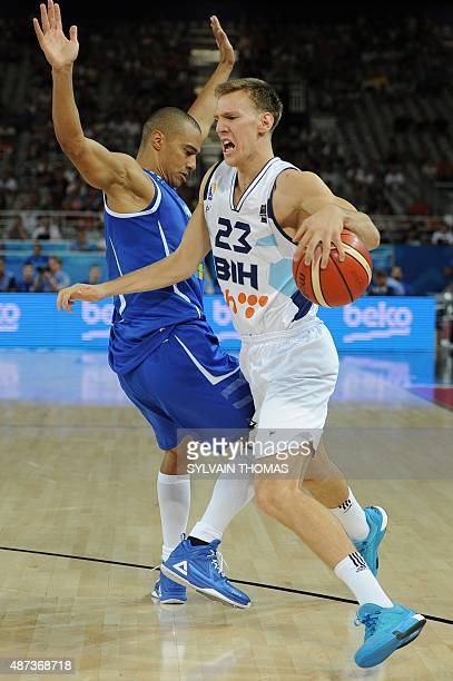 Bosnia and Herzegovina's Adin Vrabac vies with Finland's Shawn Huff during a groupe A qualification basketball match between Bosnia and Herzegovina...