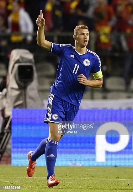 Bosnia and Herzegovina's Edin Dzeko celebrates after scoring during the Euro 2016 qualifying match between Belgium and Bosnia and Herzegovina at the...