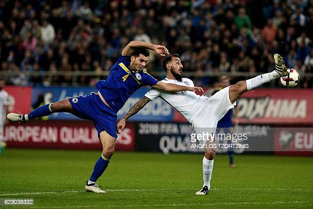 Bosnia and Herzegovina's Ermin Bicakcic vies for the ball with Greece's Kostas Mitroglou during the 2018 World Cup football qualification match...