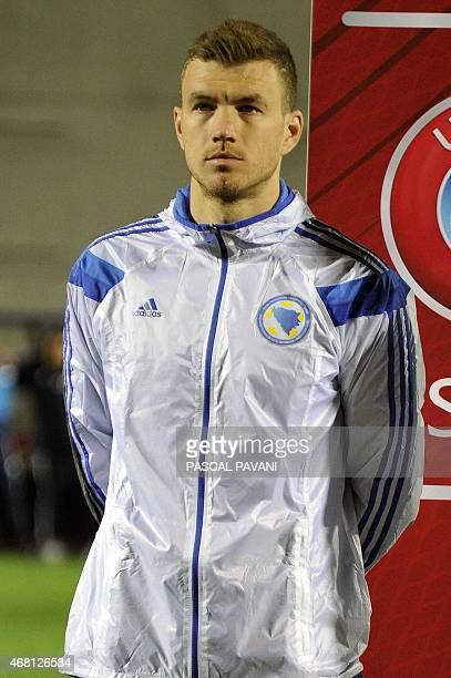 Bosnia and Herzegovina's forward Edin Dzeko poses ahead of Euro 2016 qualifying football match between Andorra and Bosnia and Herzegovina on March 28...