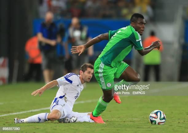 Bosnia and Herzegovina's Haris Medunjanin and Nigeria's Emmanuel Emenike battle for the ball