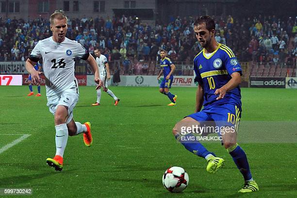 Bosnia and Herzegovina's Miralem Pjanic vies for the ball with Estonia's Ilja Antonov during the FIFA World Cup 2018 football qualification match...