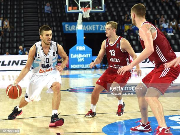 Bosnia and Herzegovina's Nemenja Gordic challenges Russia's Andrey Zubkov and Dmitry Khvostov during the 2015 EuroBasket group A basketball match...