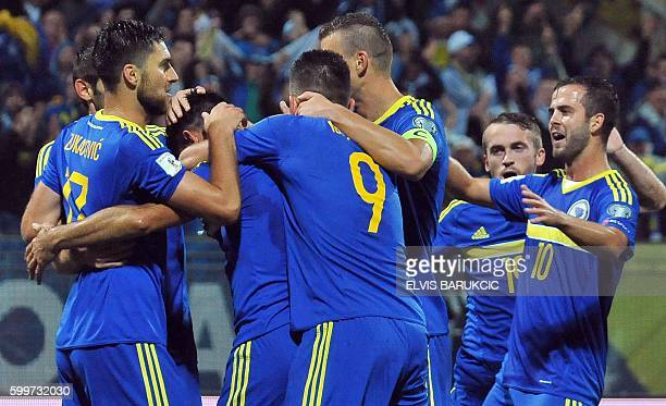 Bosnia and Herzegovina's players celebrate after scoring during the FIFA World Cup 2018 football qualification match between Bosnia and Herzegovina...