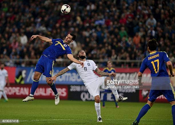 Bosnia and Herzegovina's Sead Kolasinac vies for the ball with Greece's Kostas Mitroglou during the 2018 World Cup football qualification match...