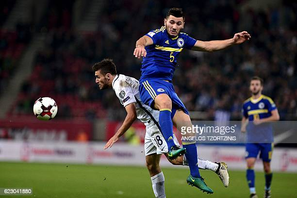 Bosnia and Herzegovina's Sead Kolasinac vies for the ball with Greece's Yannis Gianniotas during the 2018 World Cup football qualification match...