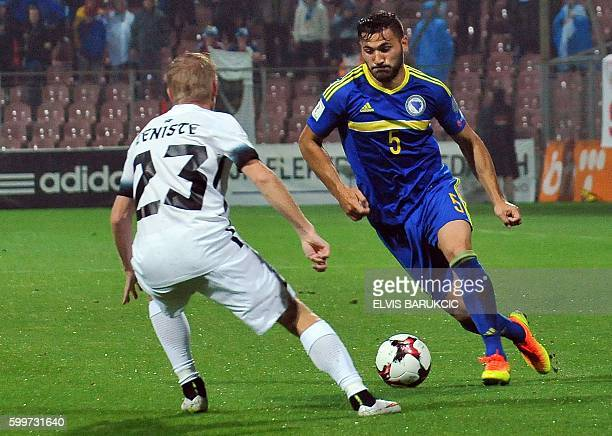 Bosnia and Herzegovina's Sead Kolasinac vies for the ball with Estonia's Taijo Teniste during the FIFA World Cup 2018 football qualification match...