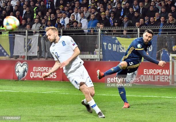Bosnia and Herzegovina's Sead Kolasinac vies with Greece's Michalis Bakakis during the UEFA Euro 2020 Group J qualification football match between...