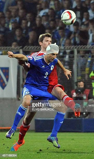 Bosnia and Herzegovina's Vedad Ibisevic heads the ball during the Euro 2016 qualifying match between Bosnia and Herzegovina and Belgium in Zenica on...