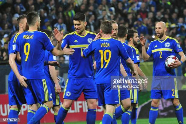 Bosnia and Herzegovina's Vedad Ibisevic is congratulated by his teammates after scoring his second goal during the FIFA World Cup 2018 qualification...