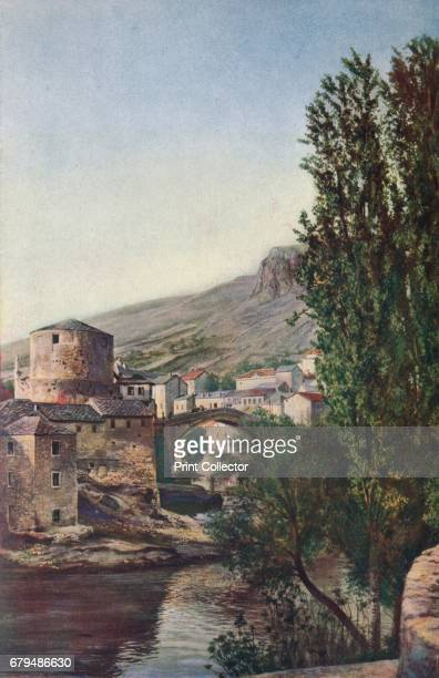 Bosnia Colossal as the bridge of Mostar is the graceful proportions of its agetinted arch give it an appearance of airy lightness' c1920 Mostar is a...
