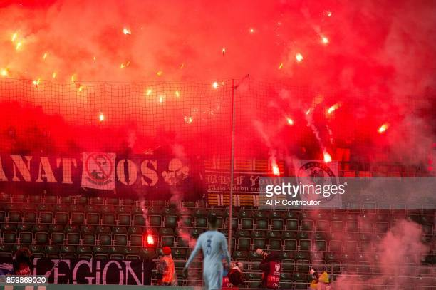 Bosnia fans light and throgh flares during the FIFA World Cup 2018 qualification football match between Estonia and Bosnia in Tallinn Estonia on...