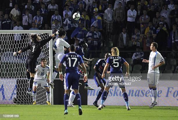 Bosnia Hercegovina's goalkeeper Kenan Hasagic deflects the ball during the Euro 2012 qualifying match Bosnia-Hercegovina vs. France at the Kosevo...