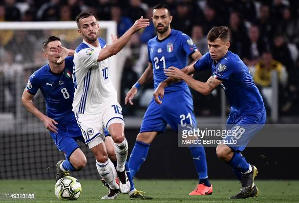 Bosnia Herzegovina midfielder Miralem Pjanic fights for the ball with Italy's midfielder Nicolo Barella during the UEFA Euro 2020 qualification...