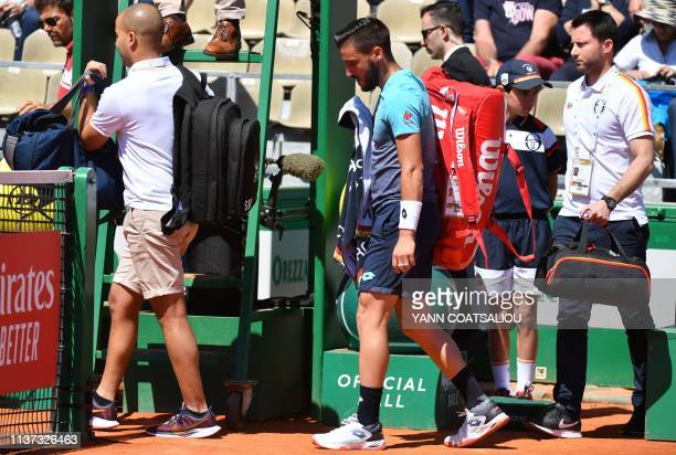 Bosnia Herzegovina's Damir Dzumhur leaves the court after he withdraw himself following an injury during his tennis match against Italy's Marco...