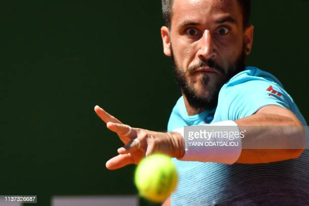 Bosnia Herzegovina's Damir Dzumhur plays a forehand return to Italy's Marco Cecchinato during their tennis match on the day 3 of the Monte-Carlo ATP...