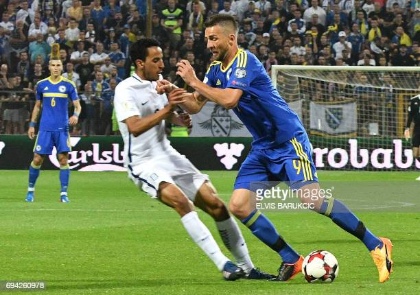 Bosnia Herzegovina's forward Vedad Ibisevic vies with Greece's midfielder Jose Carlos Goncalves Rodrigues aka Zeca during the FIFA World Cup 2018...