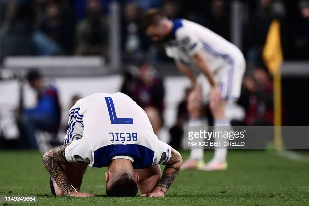 Bosnia Herzegovina's midfielder Muhamed Besic puts his head on the pitch during the UEFA Euro 2020 qualification football match between Italy and...