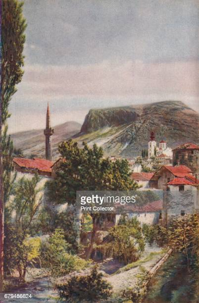 Bosnia Pencilpointed minarets and the noble Greek cathedral at the foot of the grim hill of Polvelez are salient features of Mostar' c1920 Mostar is...