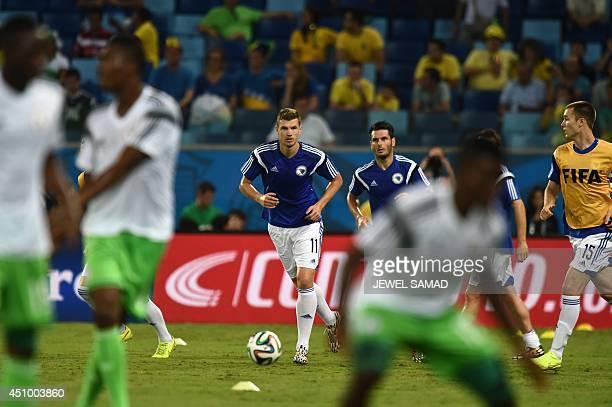 BosniaHercegovina's forward Edin Dzeko warm up before the Group F football match between Nigeria and BosniaHercegovina at the Pantanal Arena in...