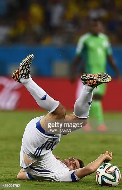 Bosnia-Hercegovina's midfielder Zvjezdan Misimovic reacts after falling during the Group F football match between Nigeria and Bosnia-Hercegovina at...
