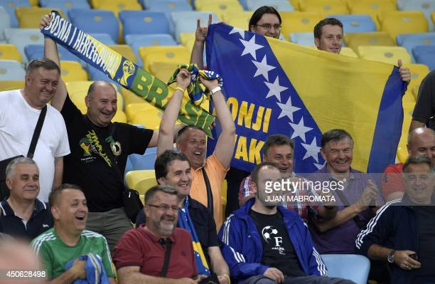 BosniaHercegovina's supporters cheer for their national squad during a training session at The Maracana Stadium in Rio de Janeiro on June 14 ahead of...