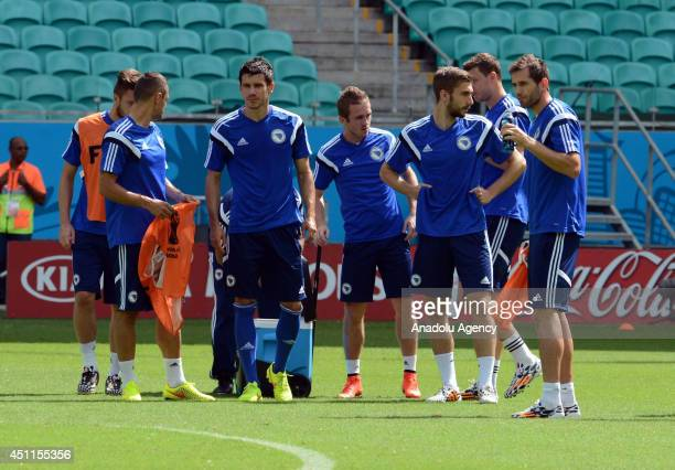 BosniaHerzegovia national football team players attend the training session at Salvador Fonte Nova stadium in Salvador Brazil on June 24 before the...