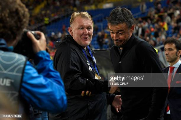 Bosnia-Herzegovina's coach Robert Prosinecki shakes hands with Spain's coach Luis Enrique before the international friendly football match between...