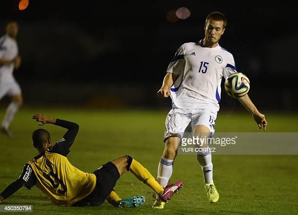 BosniaHerzegovina's defender Toni Sunjic dribbles the ball past a defender during a friendly match between Bosnia and Herzegovina and Santos U21 at...