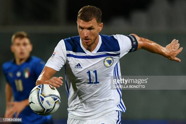 Bosnia-Herzegovina's forward Edin Dzeko eyes the ball during the UEFA Nations League football match Italy vs Bosnia and Herzegovina on September 4,...