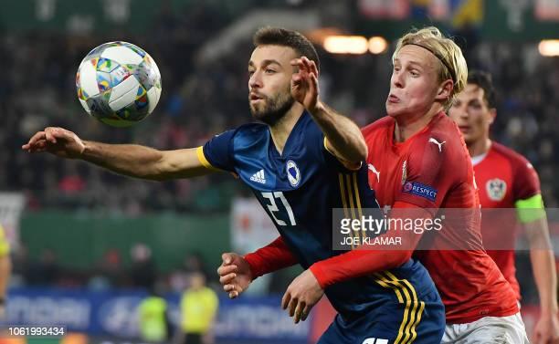 BosniaHerzegovina's midfielder Elvis Saric and Austria's midfielder Xaver Schlager vie for the ball during the UEFA Nations League football match...