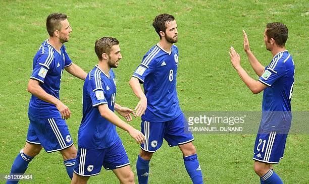 BosniaHerzegovina's midfielder Miralem Pjanic celebrates scoring his team's second goal as BosniaHerzegovina's midfielder Anel Hadzic...