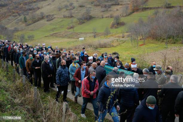 Bosniak centre-right Democratic Action Party members and relatives attend the funeral ceremony of the deceased Bosniak mayoral candidate Mirsad Peco,...