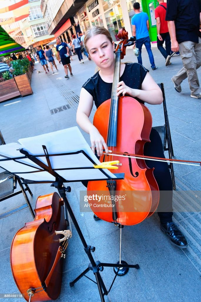 Bosnian cellist, Fatima Muhedinovic plays Adagio in G-minor by Tomaso Albinoni, in central Sarajevo, on August 19, 2017, in tribute to the victims of the Spain's terror attacks. The same piece was played on La Rambla square in Barcelona in tribute to the victims of the Sarajevo siege during the Bosnian war in 1992-95. /