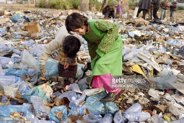 Bosnian children look for food in a UN garbage dump on November 13 in Sarajevo AFP PHOTO PATRICK BAZ