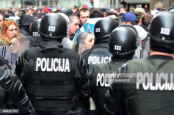 Bosnian citizens' rights activists argue with riot police as they gather in front of Bosnia and Herzegovina's Presidency building in country's...