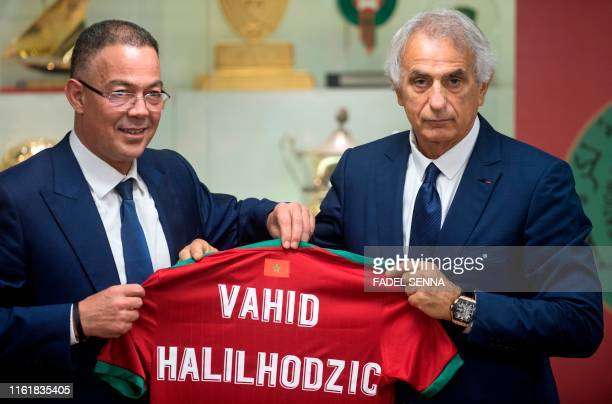Bosnian coach Vahid Halilhodzic poses with Fouzi Lekjaa , President of Morocco's Royal Football Federation , after signing on as the new coach of the...