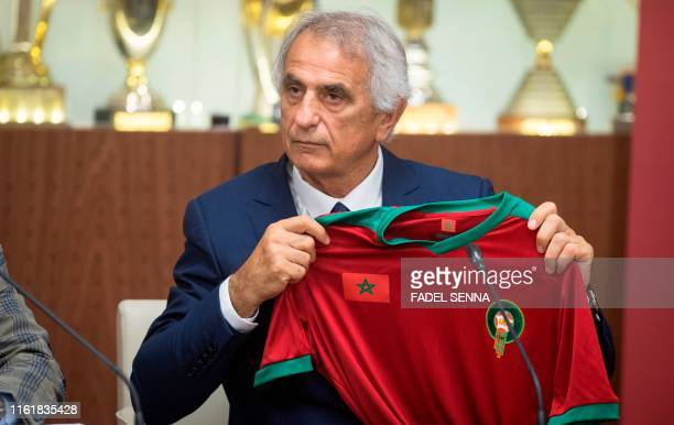 Bosnian coach Vahid Halilhodzic poses with Morocco's national team jersey after signing on as the new coach during a press conference in the capital...