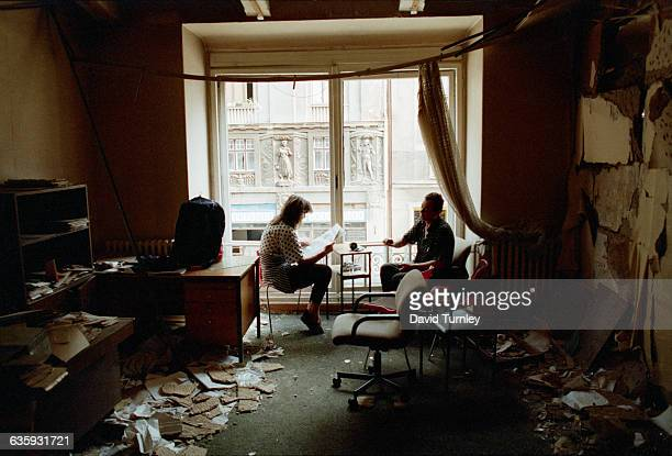 A Bosnian couple reads the newspaper in their bombedout apartment along Marshal Tito Avenue in Sarajevo