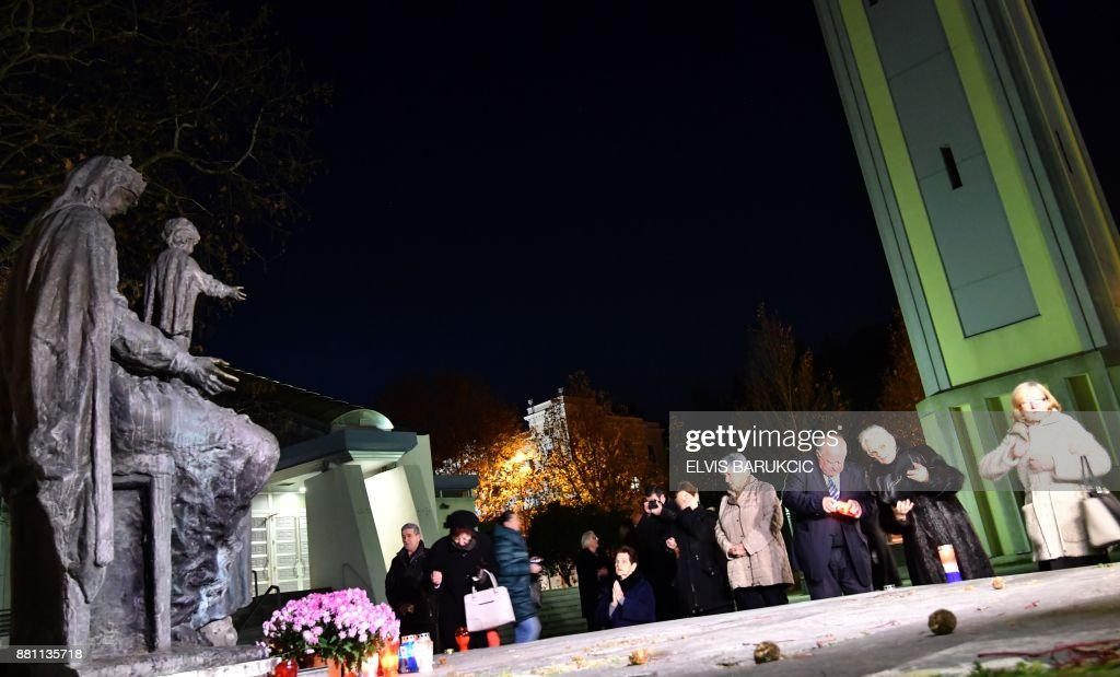 Bosnian Croats, citizens of the Bosnian southern city of Mostar, light candles prior to taking part in a prayer at city's 'Cathedral of Holly Mother Mary', late on November 28, 2017. On November 29, 2017, UN judges will hand down their last judgement for war crimes committed in the 1990s Bosnian conflict, in the appeal case of six former Bosnian Croat political and military leaders. BARUKCIC
