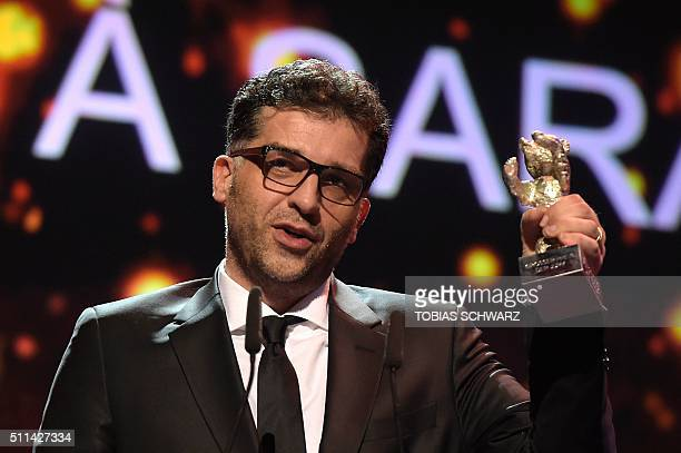 Bosnian director Danis Tanovic speaks after receiving the Silver Bear Grand Jury Prize trophy for his film 'Death in Sarajevo' during the awards...