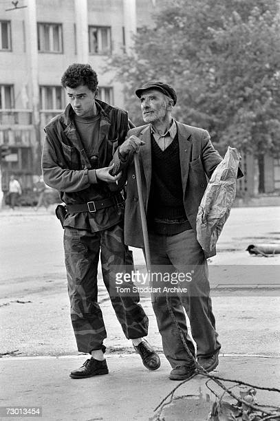 Bosnian fighter ignores the risk from snipers to bravely help an elderly man cross a dangerous intersection on Sniper Alley. During the 47 months...
