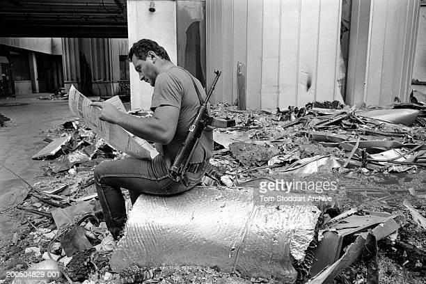 Bosnia Sarajevo July 1992 A Bosnian fighter reads a copy of Oslobodenje at the Sarajevo newspapers destroyed offices During the 47 months between the...