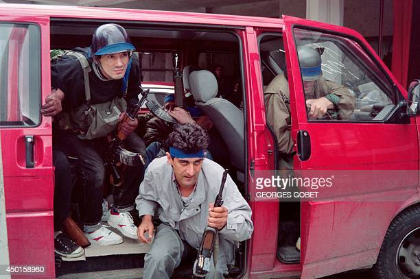 Bosnian fighters exit a civil van as they arrive in the western suburbs of Sarajevo on June 09 1992 during heavy fightings with Serbian irregulars...