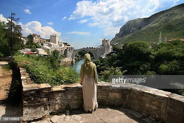 Bosnian girl looking at famous old Mostar bridge...Bosnia and Herzegovina