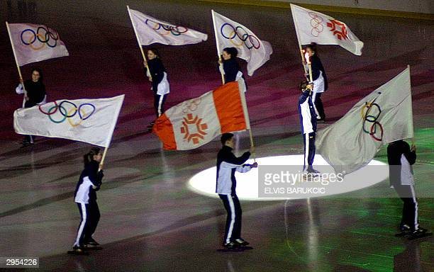 Bosnian ice skaters perform during the ceremony of marking the 20th anniversary of XIV Winter Olympic Games at the Olympic hall of Zetra in Sarajevo...