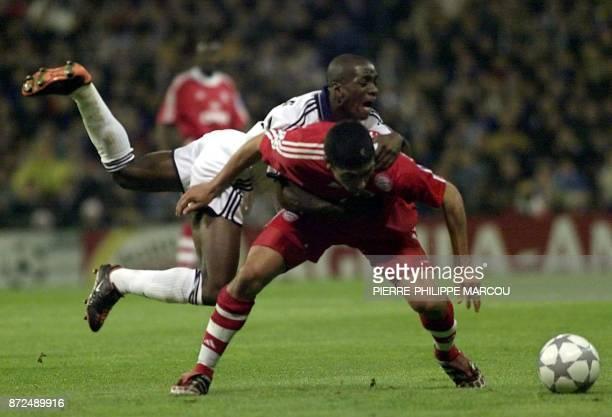 Bosnian international Hasan Salihamidzic of Bayern Munich fouls French international Claude Makelele of Real Madrid during the semifinal match of the...