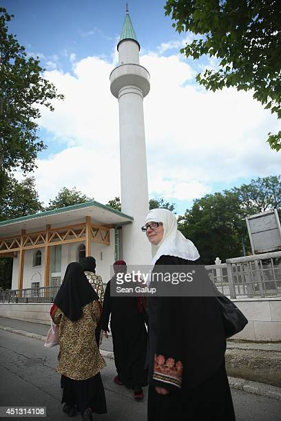 Bosnian Muslim arrive to look at a restored mosque near the Latin Bridge not far from the location where Austrian Archduke Ferdinand was assassinated...