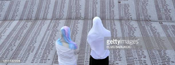 ANNIVERSARY Bosnian Muslim survivors of Srebrenica massacre in 1995 look for the names of their relatives on stone monument at memorial center in...